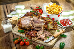 Roasted pork knuckle with french fries Royalty Free Stock Photos