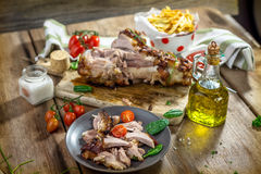 Roasted pork knuckle with french fries Royalty Free Stock Photography