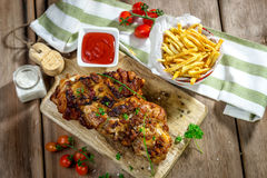 Roasted pork knuckle with french fries Royalty Free Stock Image