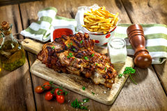 Roasted pork knuckle with french fries Stock Image