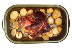 Roasted pork knuckle with potatoes Stock Photos