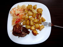 Roasted pork knuckle with potatoes Royalty Free Stock Photography