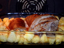 Roasted pork knuckle with potatoes Royalty Free Stock Image