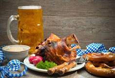 Roasted pork knuckle with pretzels and beer. Royalty Free Stock Images