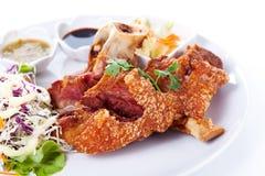Roasted pork knuckle with sauce Stock Photos