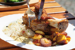 Roasted pork knuckle with sauerkraut and rosted pota Royalty Free Stock Images