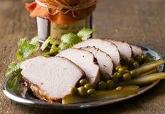 Roasted pork loin. Roasted sliced pork loin the plate royalty free stock photos