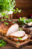 Roasted pork loin with cranberry Royalty Free Stock Photography