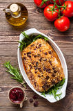 Roasted pork loin with cranberry and rosemary Royalty Free Stock Photos