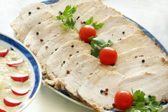 Roasted pork loin with herbs cut into slices Stock Photography