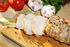 Roasted pork loin with herbs on wood background Royalty Free Stock Images