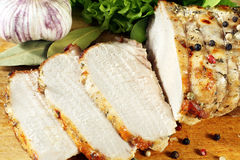 Roasted pork loin with herbs on wood background Stock Photography
