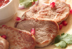 Roasted pork loin steaks Stock Photo