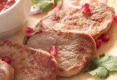 Roasted pork loin steaks Stock Photo