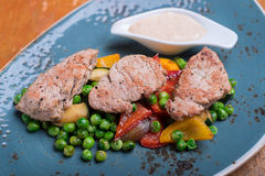 Roasted pork meat fillet chops with zucchini Stock Photo