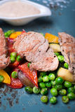 Roasted pork meat fillet chops with zucchini Royalty Free Stock Image