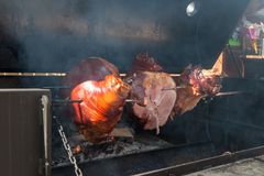 Roasted pork meat on spit royalty free stock photos