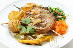 Roasted pork medallion dish with carrot puree, pies and potatoe Stock Photography