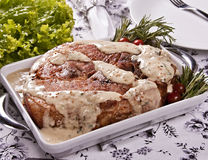 Roasted pork with mustard sauce, rosemary and cherry tomato Royalty Free Stock Photo