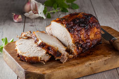 Roasted pork. Oven roasted pork loin on a cutting board in a rustic kitchen stock photos