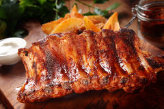 Roasted Pork Rib on Wooden Chopping Board Royalty Free Stock Photography