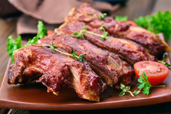 Roasted pork ribs on plate Royalty Free Stock Photos