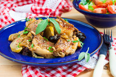 Roasted pork ribs with plums and apples Royalty Free Stock Image
