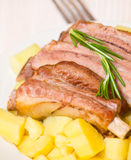 Roasted pork ribs with potatoes Stock Photos