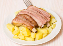 Roasted pork ribs with potatoes Royalty Free Stock Photos