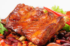 Roasted pork ribs with vegetables Stock Image