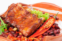 Roasted pork ribs with vegetables Royalty Free Stock Image
