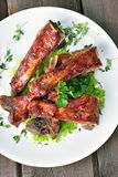 Roasted pork ribs on white plate Royalty Free Stock Photography
