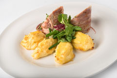 Roasted pork roll stuffed with rice and potatoes Stock Photography