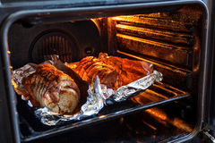 Roasted pork roll stuffed with vegetables and garlic stock photography