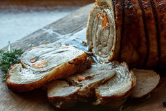 Roasted pork roll stuffed with vegetables on wooden board Royalty Free Stock Photography