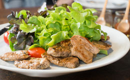 Roasted pork salad. On wood table Royalty Free Stock Photography