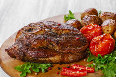 Roasted pork shoulder on the bone Royalty Free Stock Photography
