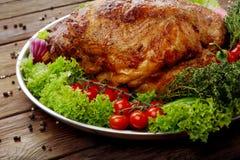 Roasted pork shoulder with vegetables, meat dish Stock Image