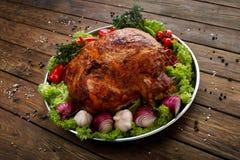 Roasted pork shoulder with vegetables, meat dish Stock Images