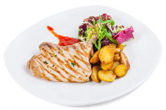 Roasted pork stake at the white plate.  royalty free stock image