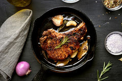 Roasted pork steak in frying pan Stock Photography