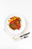 Roasted pork steak with grilled vegetables Stock Image