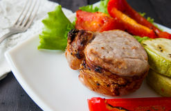 Roasted pork steak with grilled vegetables Royalty Free Stock Photography