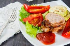 Roasted pork steak with grilled vegetables Stock Image