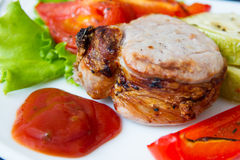 Roasted pork steak with grilled vegetables Stock Photo