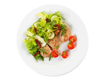 Roasted pork steak with salad Royalty Free Stock Photography
