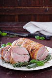 Roasted pork tenderloin with herbs Royalty Free Stock Image