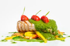 Roasted pork tenderloin with vegetable saute Royalty Free Stock Photography