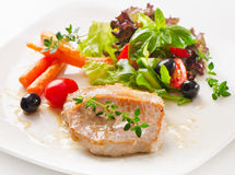 Roasted  pork with vegetables Stock Images