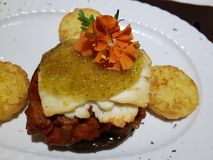 Roasted portobello mushroom. With sheep`s cheese and fig mustard on Ratatouille vegetables and Potato coins stock image